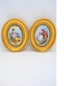 Pair of gilt framed painted porcelain panels