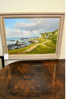 Framed oil painting of Ballintoy
