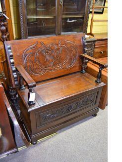 Carved oak monks bench