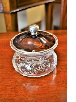 Silver rimmed cut glass jar and lid