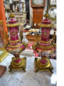 Pair of porcelain gilt bronze Urns