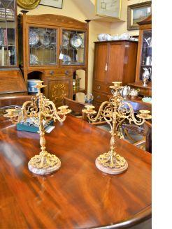 Pair of gilt framed candlesticks