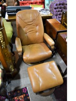 Leather reclining armchair with matching stool