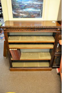 Carved oak floor bookcase