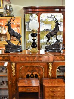 Pair of bronze stag figures on marble plinths