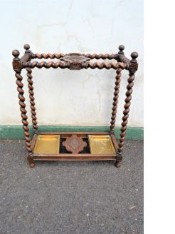 Victorian oak stick stand with brass trays