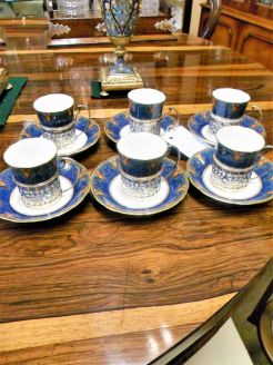 Set of six coffee cups ,saucers,silver holders