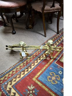 Brass fire irons and dogs
