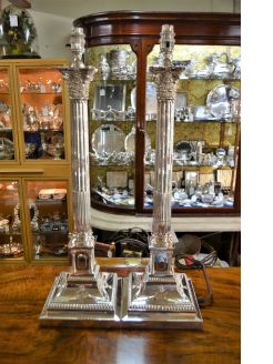 Pair of silver lamps