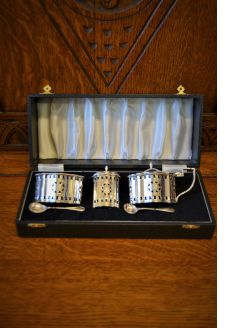 Five piece silver condiment set