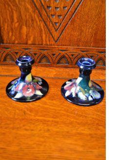 Pair of moorcroft porcelain candlesticks