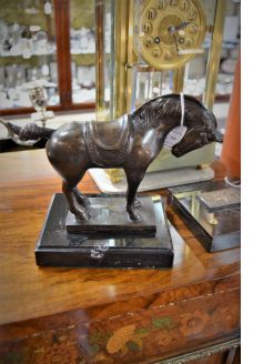Bronze horse mounted on marble plinth