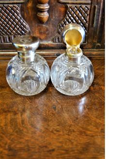 Pair of silver top scent bottles