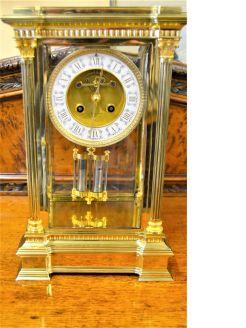 Victorian brass four glass clock