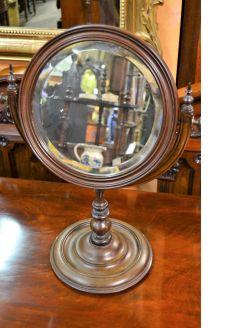 Circular mahogany shaving mirror