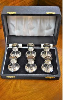 Set of six silver menu holders
