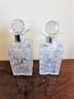 Pair of spirit decanters with silver collars