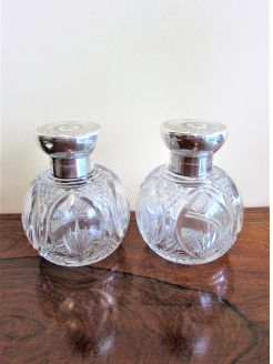 Pair of silver topped scent bottles