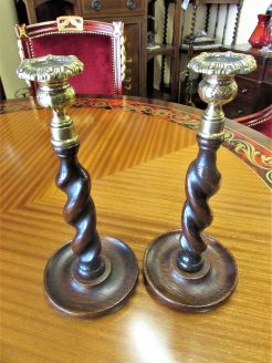 Pair of oak twist & brass candlesticks