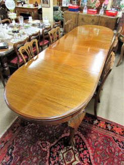 Mahogany four leaf dining table