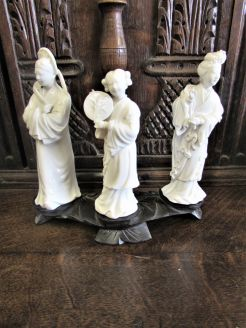 Chinese figures on carved wooden stand