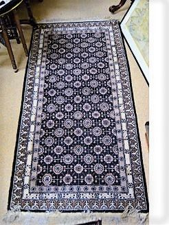 Old rug  (black & cream)