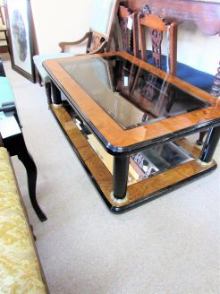 Glass coffee table with mirrored base