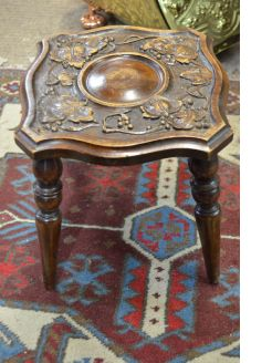 Carved mahogany stool
