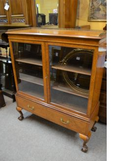 Two door walnut display cabinet
