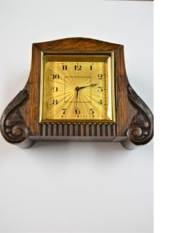 Small art deco oak cased mantle clock