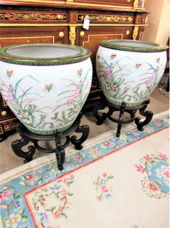 Pair of large chinese oriental pots on wooden stands