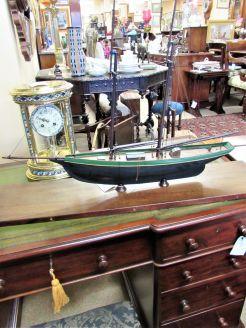 Model wooden boat on plinth