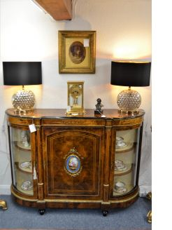 Burr walnut credenza with gilt mounts & porcelain plaques.