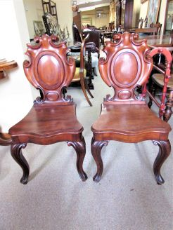 Pair mahogany hall chairs