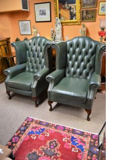 Pair of wing back leather armchairs