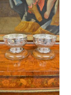 Pair of silver rose bowls on wooden stands