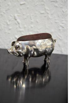 Silver pig pin cushion