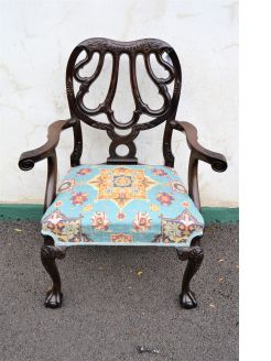 Carved mahogany armchair with ball & claw feet