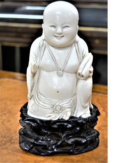 Chinese carved buddha  (composite resin) on carved  stand