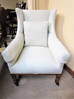 Oak wing back armchair