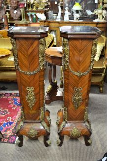 Pair of kingwood & gilt metal mounted torchers