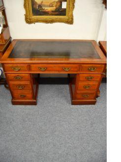 Edwardian mahogany leather top pedestal desk