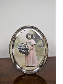 Large silver oval photo frame