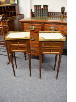 Pair of mahogany marble top pedestal chests