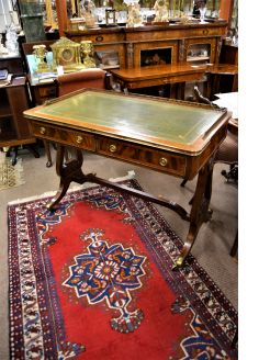 Mahogany leather top desk with brass gallery