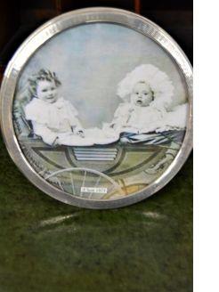 Circular silver photo frame
