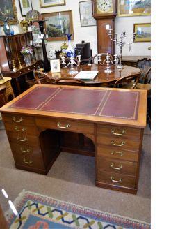 Edwardian oak leather top desk