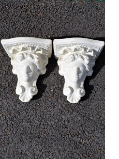 Pair of old plaster wall brackets