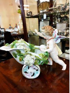 Continental porcelain cherub