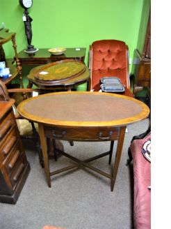 Mahogany leather top oval writing table